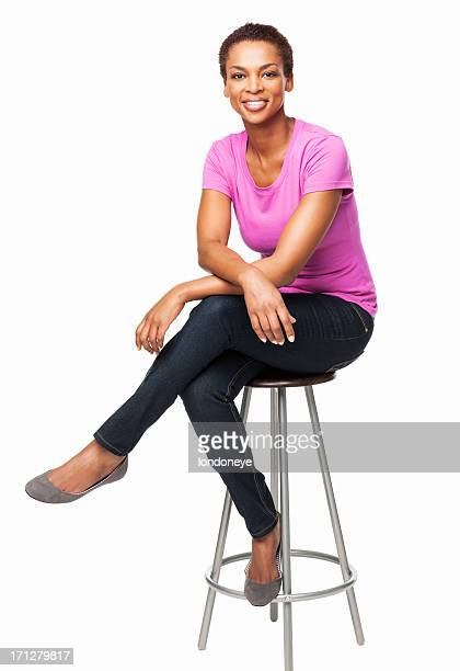 smiling african american woman sitting on chair - isolated - sitting stock pictures, royalty-free photos & images