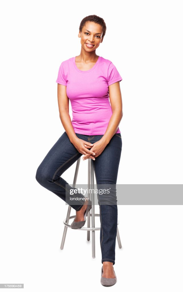 Smiling African American Woman Sitting On Chair - Isolated : Stock Photo