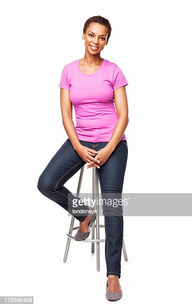 smiling african american woman sitting on chair - isolated - stool stock pictures, royalty-free photos & images