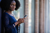 african immigrant woman using smartphone street