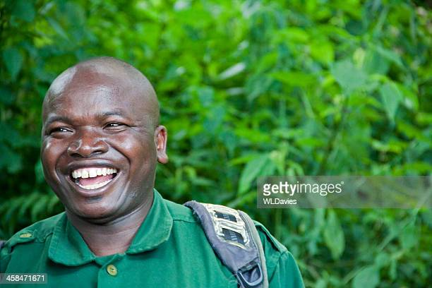 smiling african man - fat black man stock photos and pictures