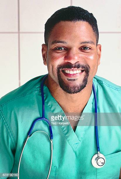 smiling african-american male nurse or doctor in scrubs. - goatee stock pictures, royalty-free photos & images