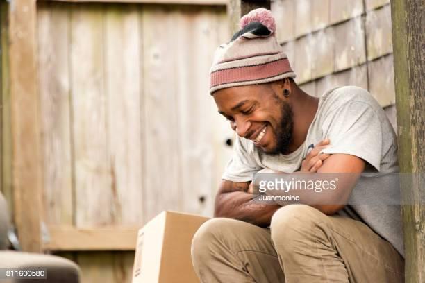 Smiling afro caribbean young man