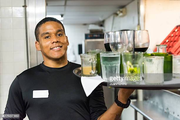 smiling afro-caribbean waiter busboy - creole ethnicity stock pictures, royalty-free photos & images