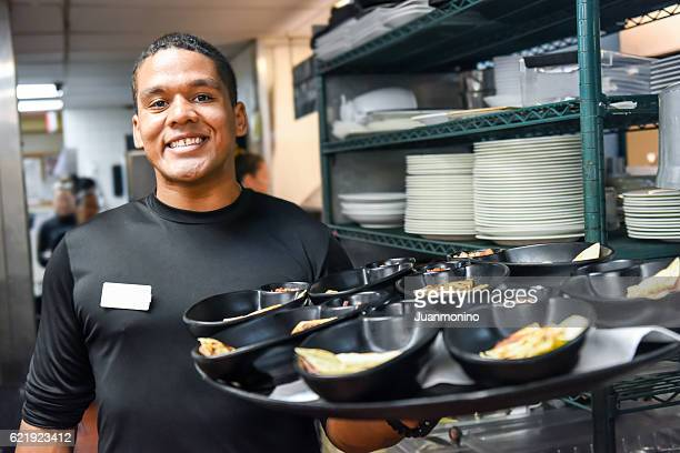 smiling afro-caribbean waiter - wait staff stock pictures, royalty-free photos & images