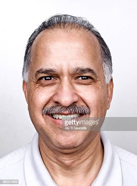 Smiling aged hispanic male