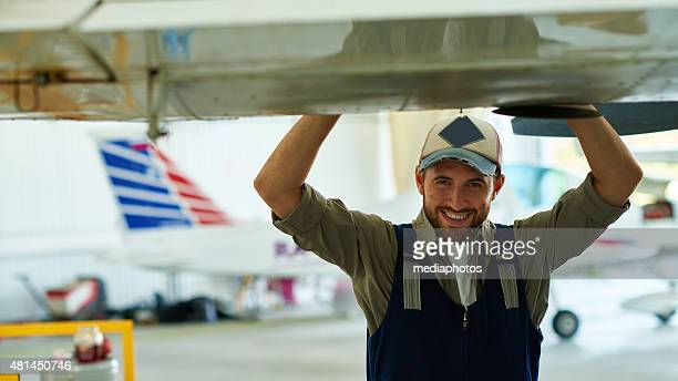 Smiling airplane engineer
