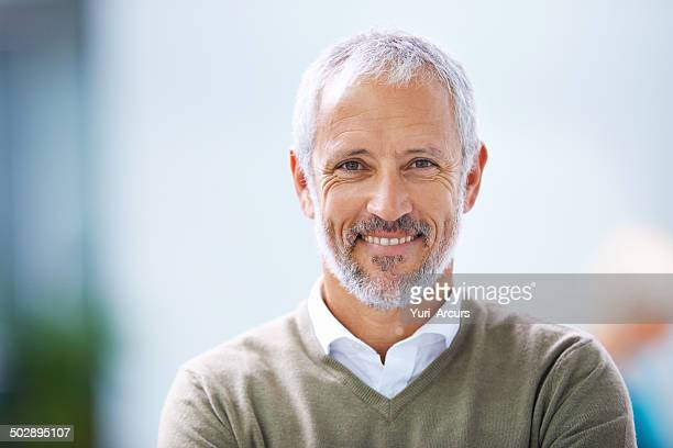 smiling all the way to success - one mature man only stock pictures, royalty-free photos & images