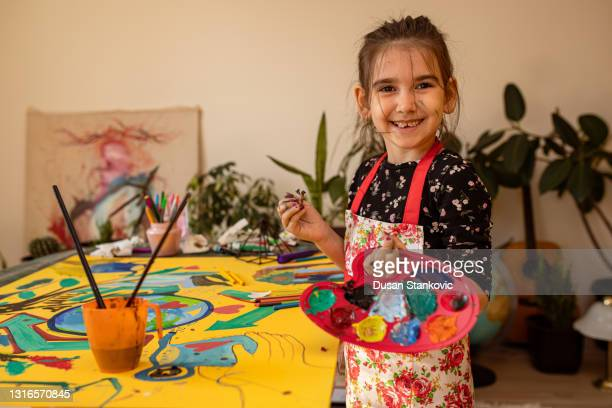 smiling  an artist - tempera painting stock pictures, royalty-free photos & images