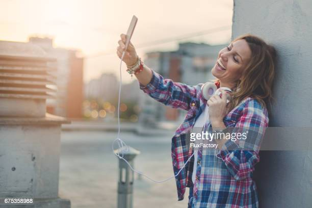 Smiling and taking selfie