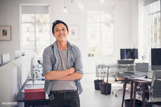 smiling architect with arms crossed in office - 前をはだけた ストックフォトと画像