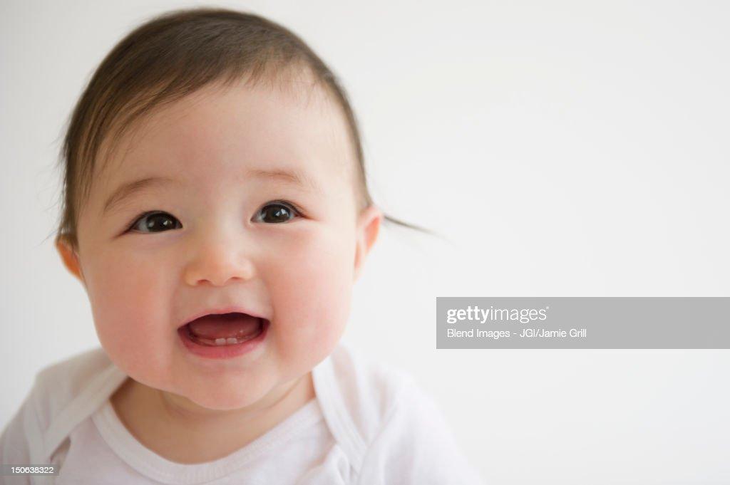 Smiling Asian baby girl : Stock Photo