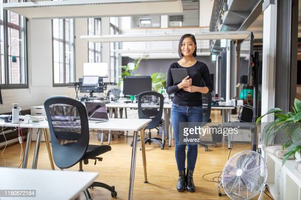 smiling asian businesswoman with digital table - smart casual stock pictures, royalty-free photos & images