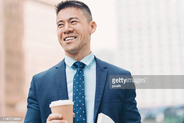 smiling asian ethnicity businessman - chinese ethnicity stock pictures, royalty-free photos & images