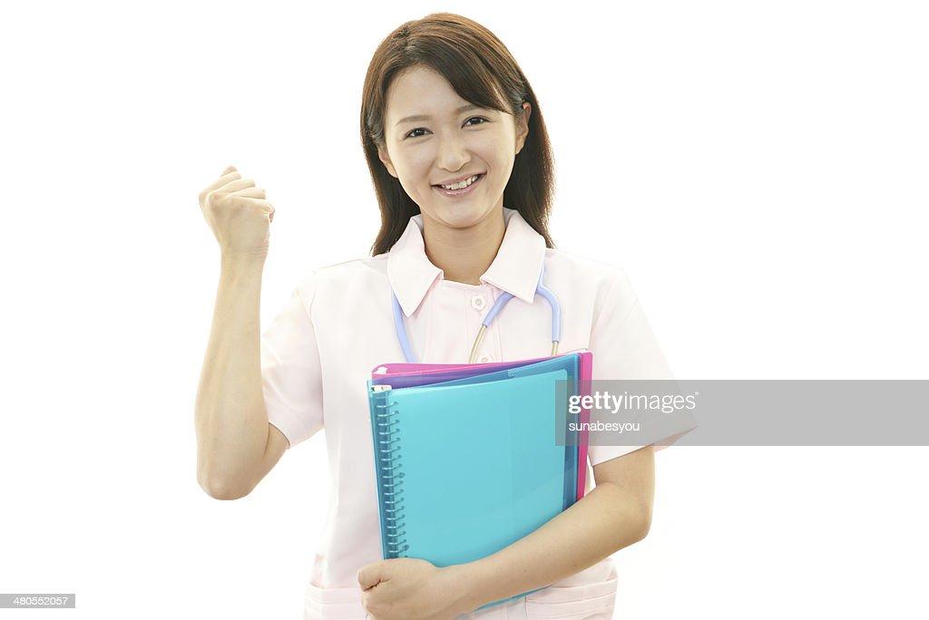 Sorridente enfermeira asiática : Foto de stock