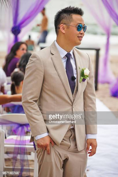 smiling asian groom waiting at the alter - beige suit stock pictures, royalty-free photos & images