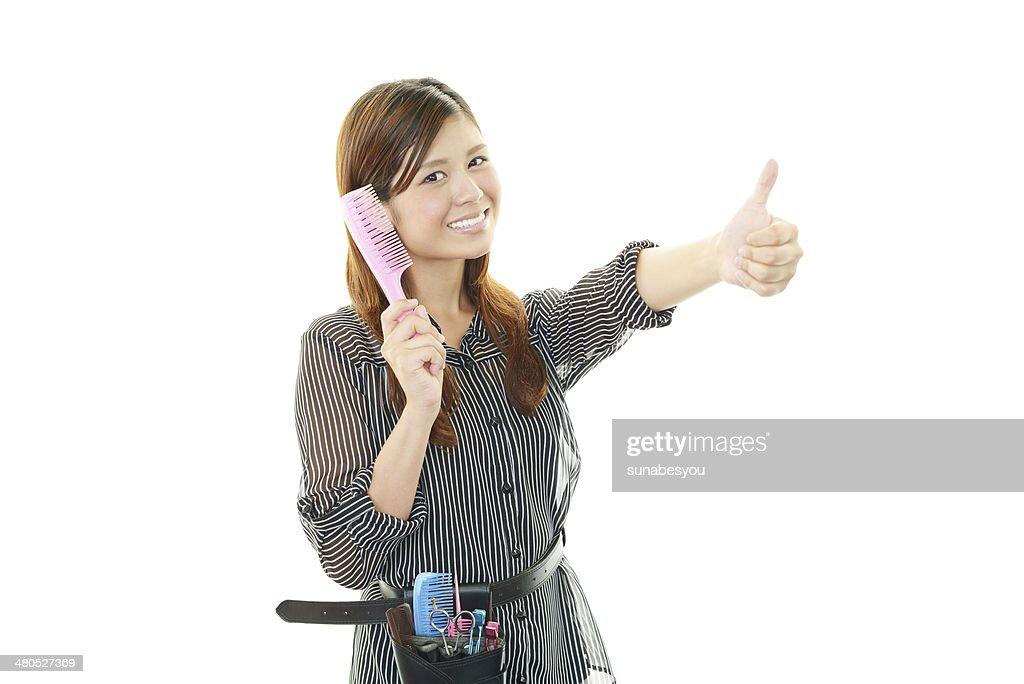 Smiling Asian hairdresser : Stock Photo