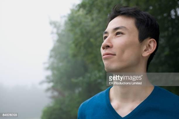 Smiling Asian man outdoors