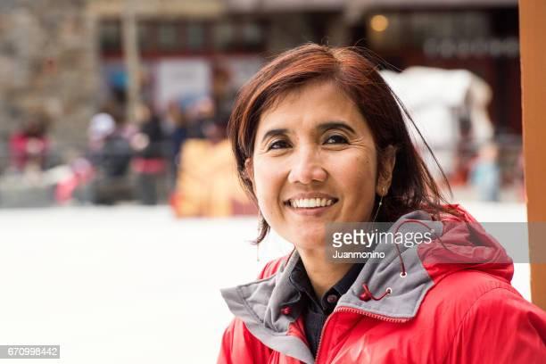 Smiling asian mature woman