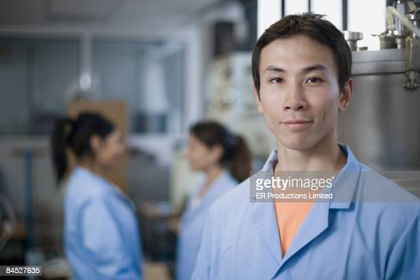 Smiling Asian scientist in laboratory