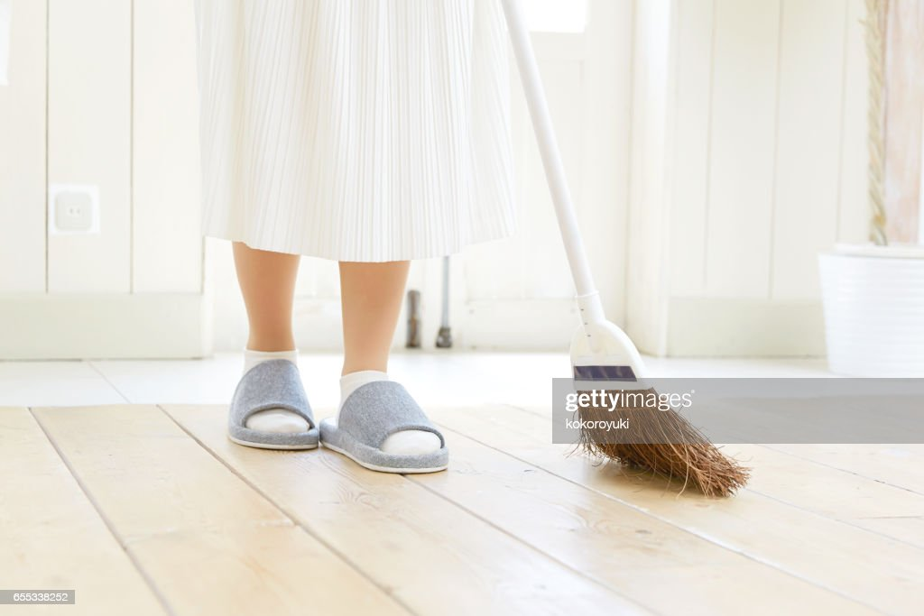smiling Asian woman cleaning the room : Stock Photo