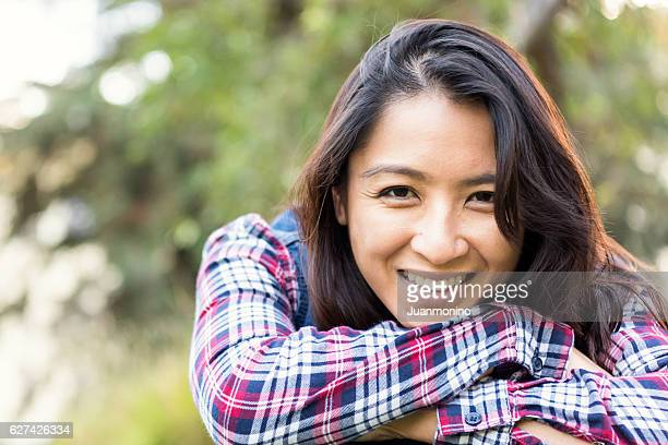smiling asian woman looking at the camera - traditionally vietnamese stock pictures, royalty-free photos & images