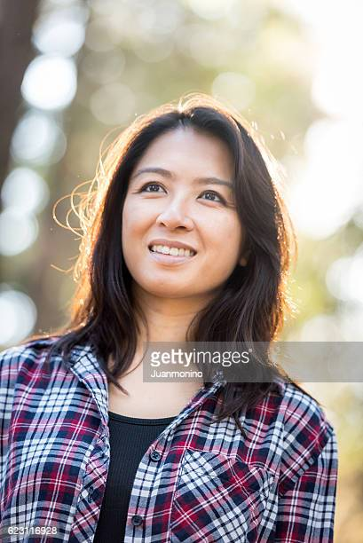 Smiling asian woman looking away