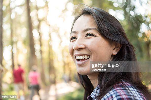 smiling asian woman looking away - mongolian women stock photos and pictures