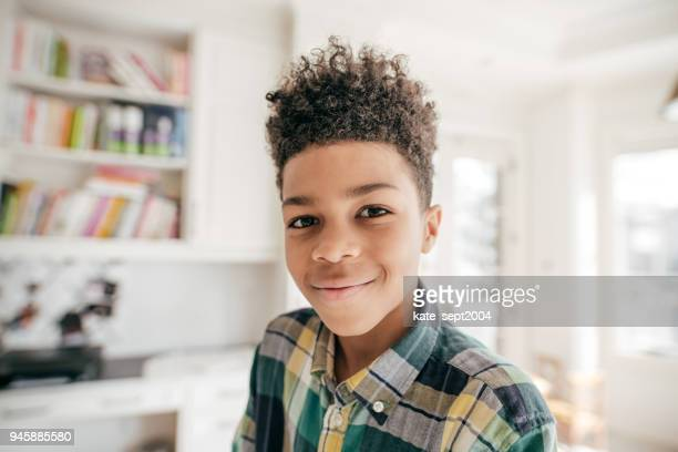 smiling at the camera. - pre adolescent child stock pictures, royalty-free photos & images