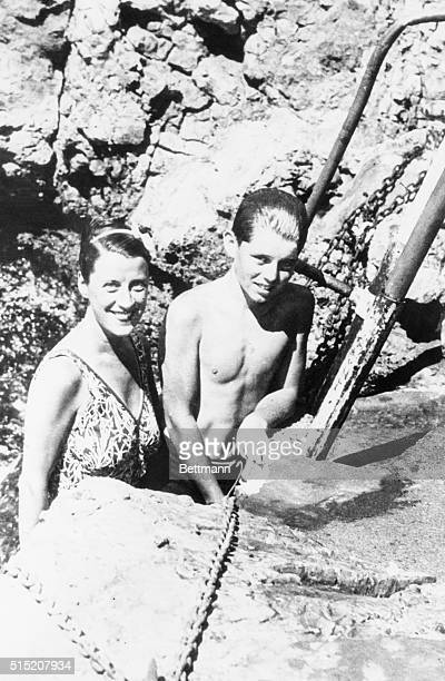 Smiling at you from a rock-bound pool at Eden Roc here are Beatrice Lillie, famous English actress who in private life is Lady Peel, and Bob Kennedy....