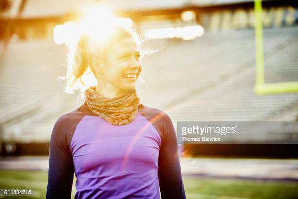 smiling athlete on field during training session - neckwear stock pictures, royalty-free photos & images
