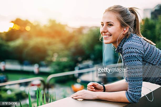 Smiling athlete resting in green area