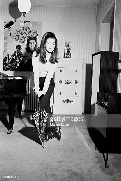 SHEILA smiling attitude of sketching a dance with an umbrella the poster for the movie 'Bang Bang' and it plays a private detective posted on the...
