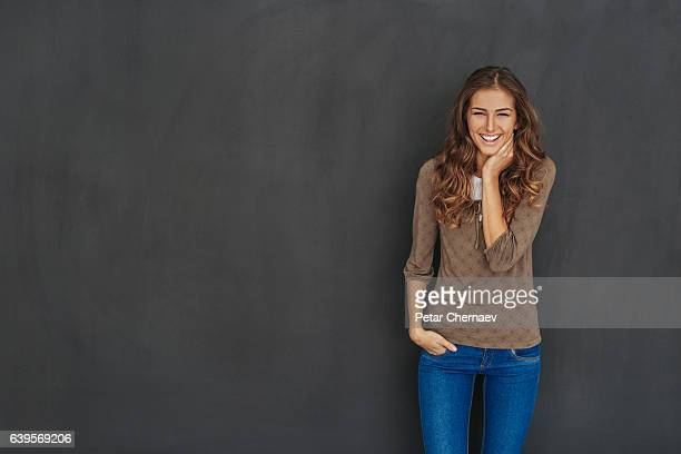smiling attractive woman at black background - beautiful black teen girl stock photos and pictures
