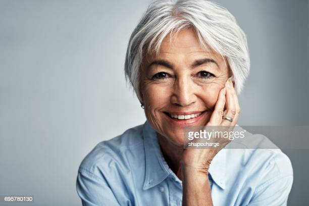smiling automatically lifts my spirits - older woman stock pictures, royalty-free photos & images