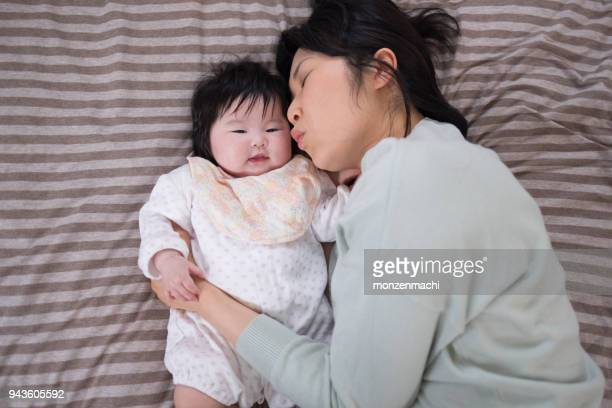 Smiling baby and mother