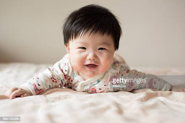 Smiling baby boy on bed