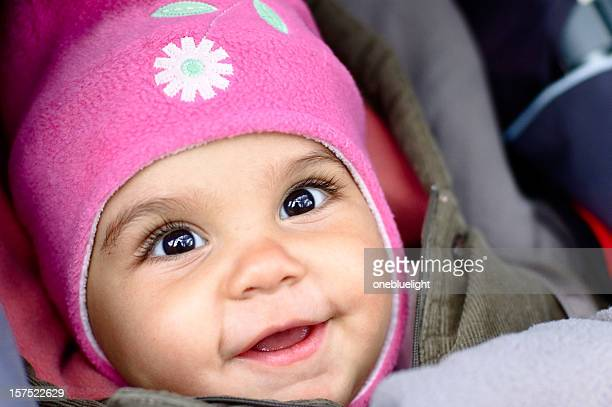 Smiling baby Child in her pushchair