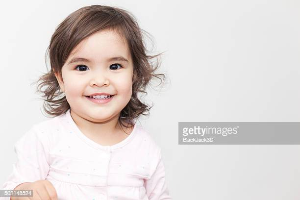 smiling baby girl - asian baby stockfoto's en -beelden