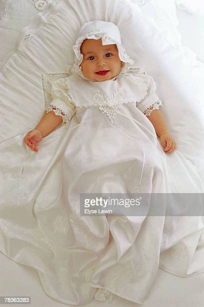 Smiling baby in baptismal gown