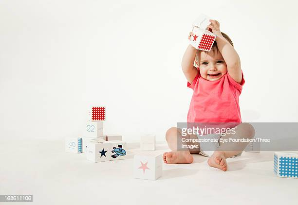smiling baby playing with wooden blocks - one baby boy only stock pictures, royalty-free photos & images