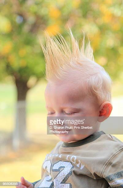 smiling baby with mohawk hairstyle - mohawk stock photos and pictures