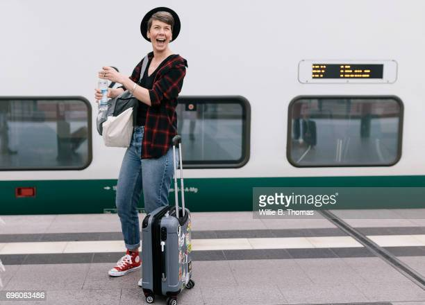 Smiling Backpacker, Excited To Board Her Train