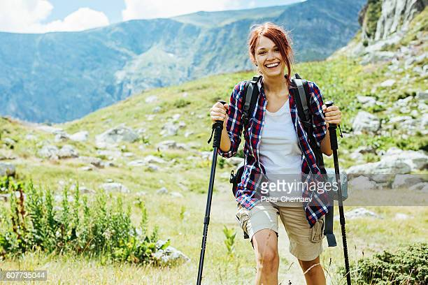 Smiling backpacker in the mountain