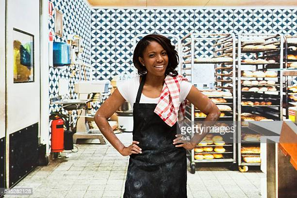 Smiling baker standing in bakery