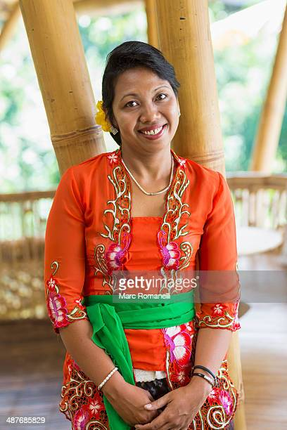 smiling balinese woman in traditional clothing - balinese culture stock pictures, royalty-free photos & images