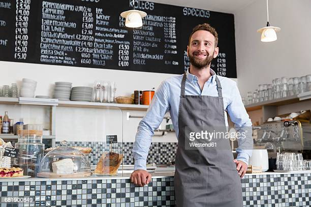 smiling barista in a cafe - waiter stock pictures, royalty-free photos & images
