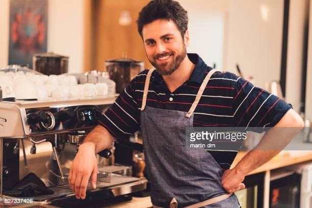 Smiling barista looking at camera