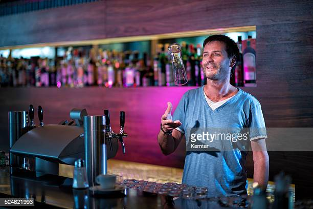 smiling barkeeper filling a glass
