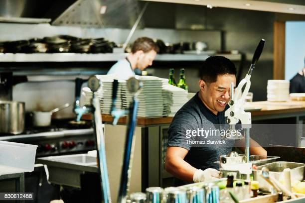 Smiling bartender preparing for evening service in restaurant